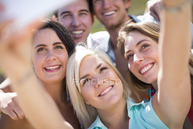 Friends taking selfies with a tablet — Stock Photo