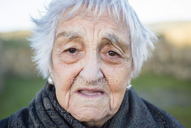 Portrait of serious senior woman looking at camera — Stock Photo
