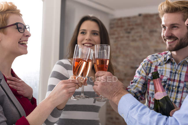 Happy businesspeople toasting with champagne glasses — Stock Photo