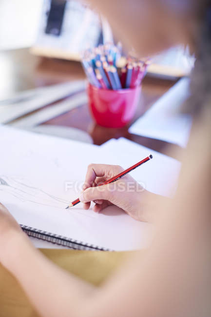 Close-up of fashion designer drawing on paper — Stock Photo