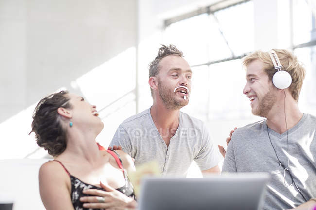 Creative office people having fun at desk — Stock Photo