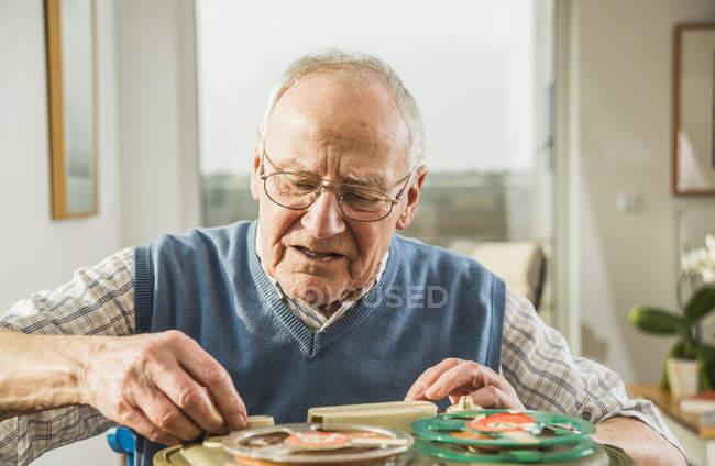 Senior man operating old-fashioned recorder — Stock Photo