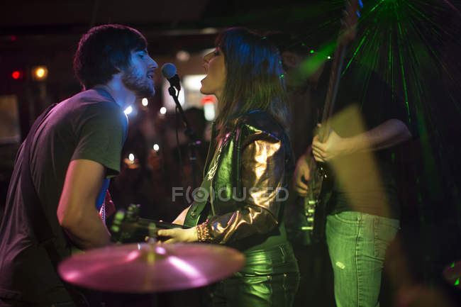 Rock band singing and playing on stage — Stock Photo