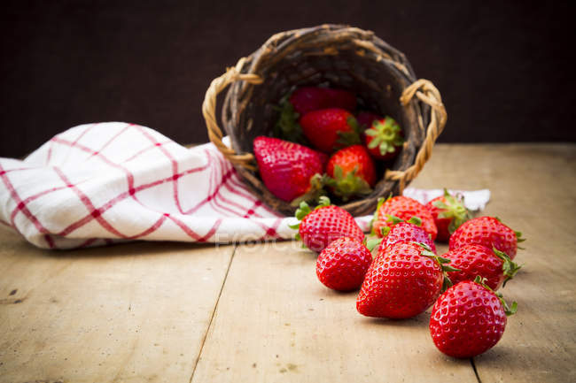 Upturned basket of strawberries — Stock Photo