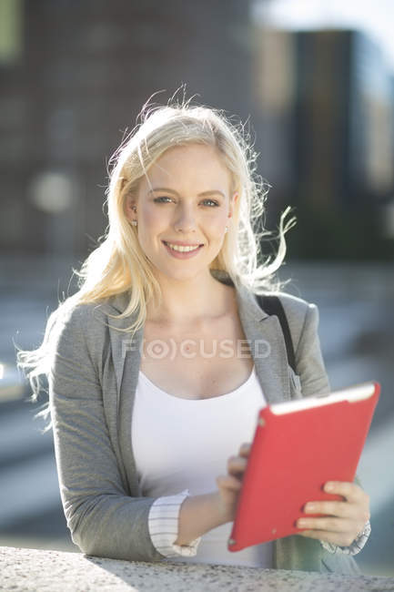 Portrait of young woman holding digital tablet — Stock Photo