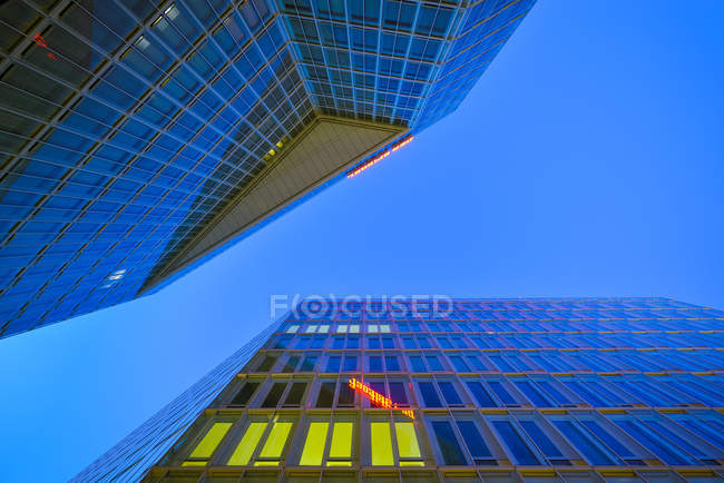 Germany, Hamburg, facades of two office towers at twilight — Stock Photo
