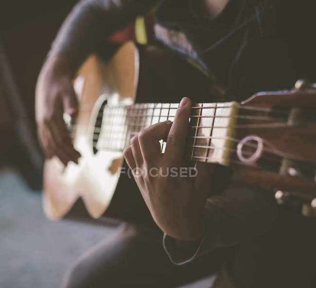 Little boy playing acoustic guitar at home, close-up — Stock Photo