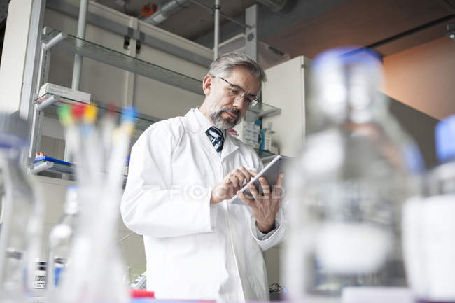 Scientist using digital tablet in laboratory — Stock Photo