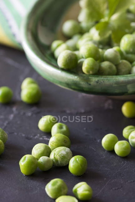 Close up of Frozen peas on slate — Stock Photo