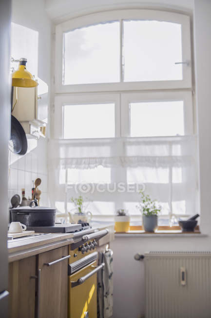 Interior of small cozy kitchen in sunlight — Stock Photo