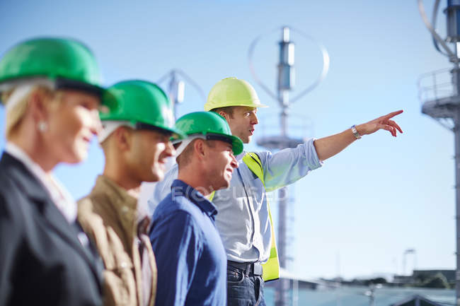 Business partners having a meeting with wind turbine engineer — Stock Photo