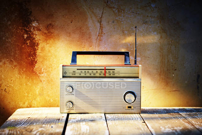 Old radio on wooden surface — Stock Photo