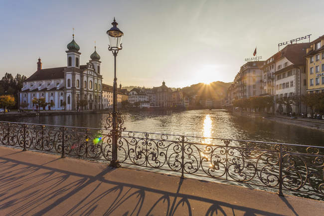 Switzerland, Canton of Lucerne, Lucerne, Old town, Reuss river, Jesuit church at sunset — Stock Photo