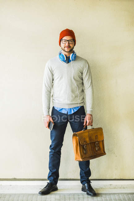 Portrait of stylish young man with leather bag — Stock Photo