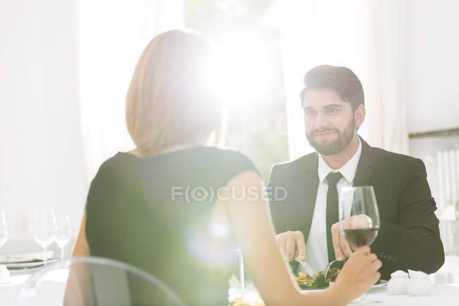 Elegant couple having dinner in restaurant — Stock Photo
