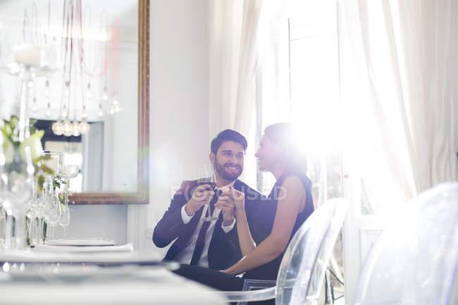 Elegant couple in restaurant — Stock Photo