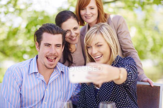 Happy friends taking selfie outdoors — Stock Photo