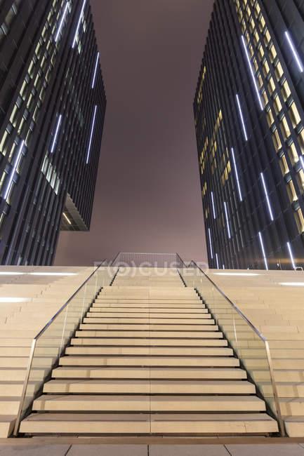 Germany, Duesseldorf, media harbor, stairs at Hyatt Regency Hotel at night — Stock Photo