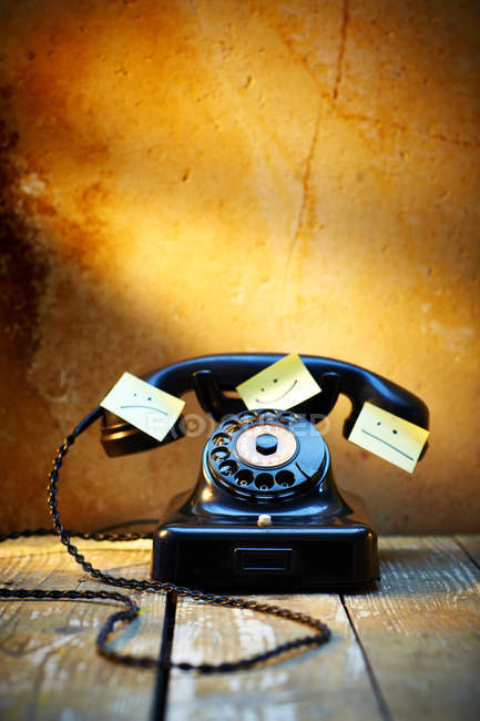 Black old bakelite telephone with adhesive notes — Stock Photo