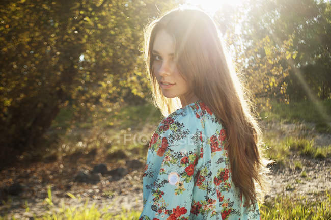 Female teenager viewing at backlight — Stock Photo