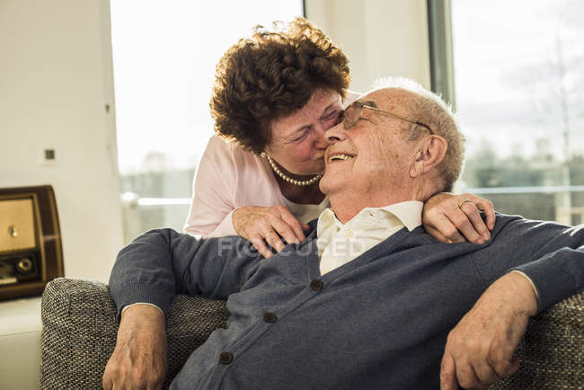Senior woman kissing her husband — Stock Photo
