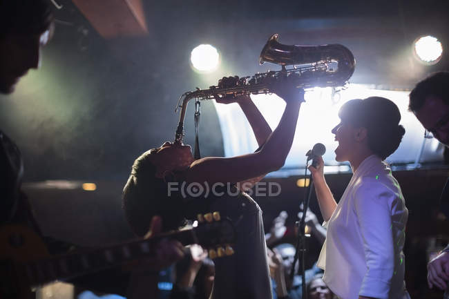 Jazz band singing and playing on stage — Stock Photo