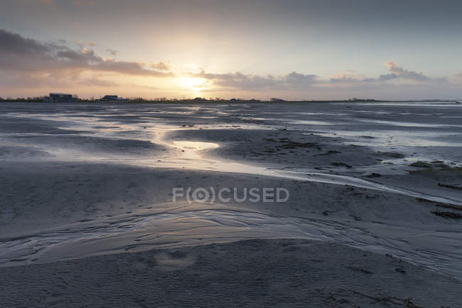 Germany, Bensersiel, coastal landscape at sunset — Stock Photo