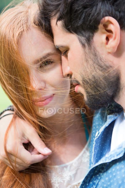 Young couple sharing an intimate moment outdoors — Stock Photo