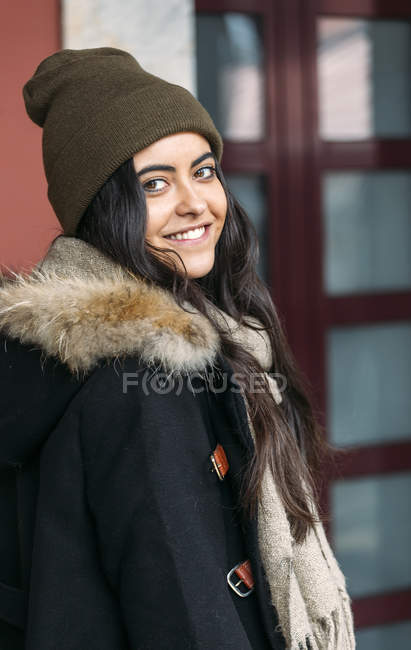 Portrait of happy young woman wearing wool cap — Stock Photo