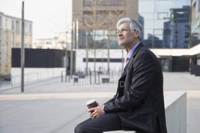 Businessman with coffee to go — Stock Photo