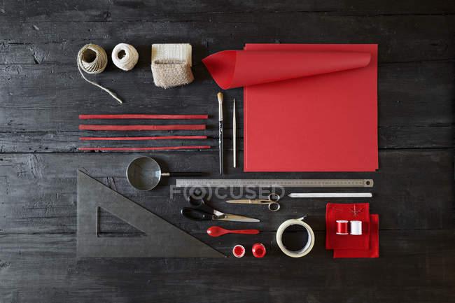 Arrangement of craft materials on black wood — Stock Photo
