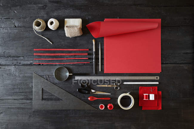 Arrangement of craft materials on black wood — Stock Photo