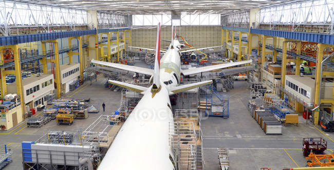 Airplane construction in hangar and industrial hall — Stock Photo