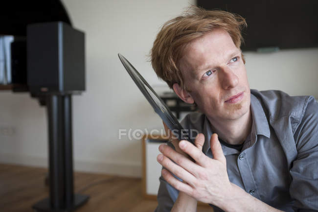 Man holding old record — Stock Photo