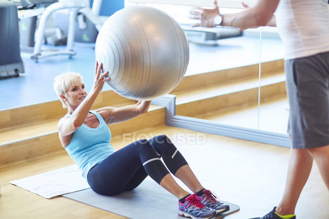 Woman with gymnastics ball in the gym — Stock Photo