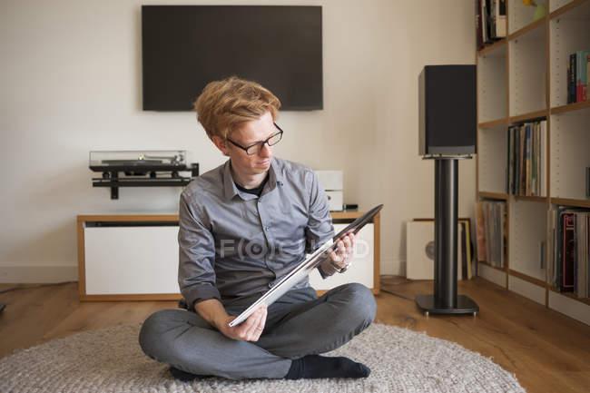 Man looking at old record — Stock Photo
