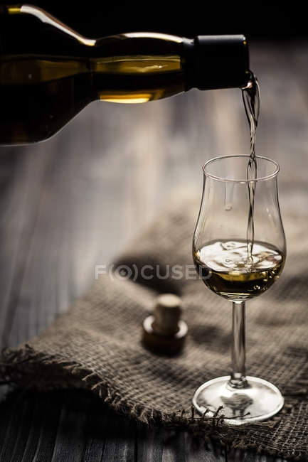Scotch single malt whiskey being poured into nosing glass — Stock Photo