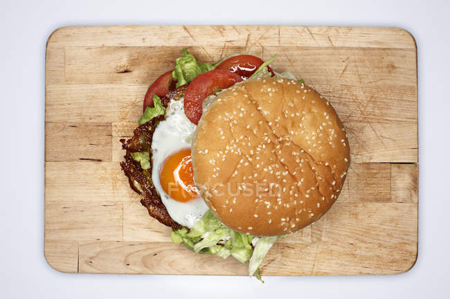 Hamburger with fried eggs, elevated view — Stock Photo