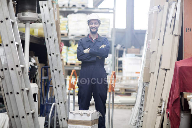 Smiling warehouseman in storehouse — Stock Photo