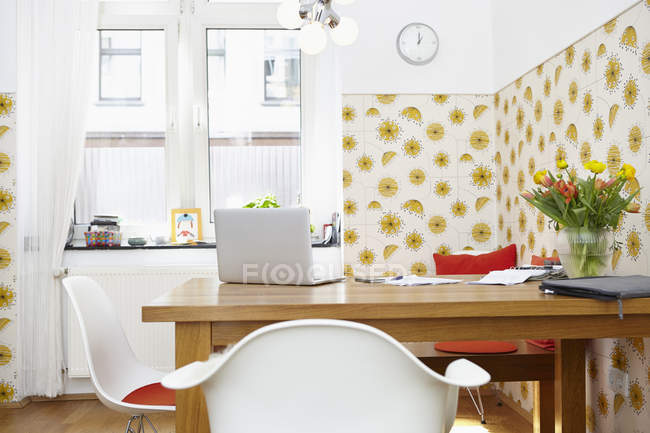 Modern home office with laptop on table — Stock Photo