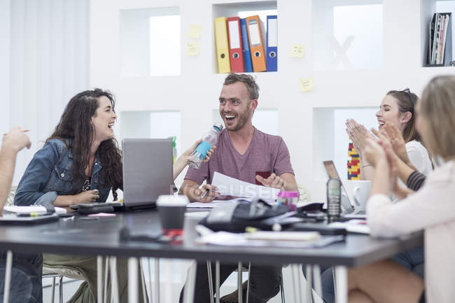 Creative office people applauding their colleague — Stock Photo
