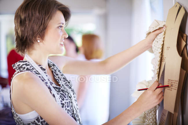 Fashion designer working on templates — Stock Photo