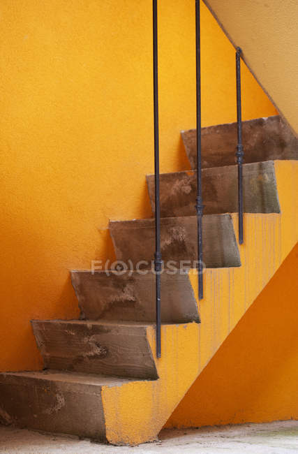 View of Stairway against orange wall — Stock Photo