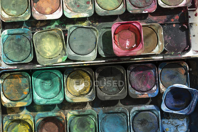 Close up of Colorful paint boxes — Stock Photo
