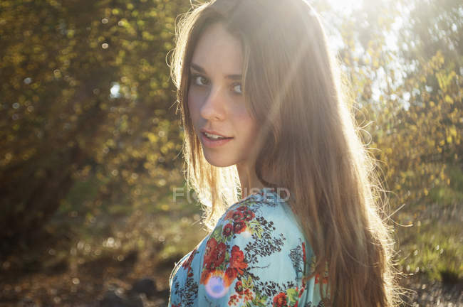 Female teenager at backlight — Stock Photo