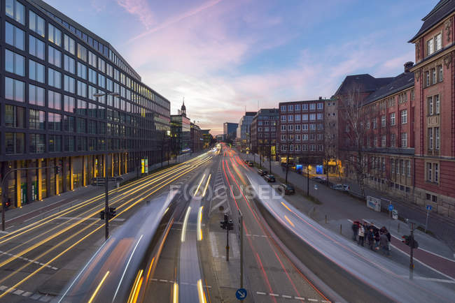 Germany, Hamburg, view to Willy-Brandt-Strasse with light trails at twilight — Stock Photo