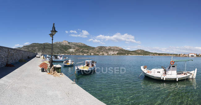 Greece, Plitra, fishing boats in harbor during dayitme — Stock Photo