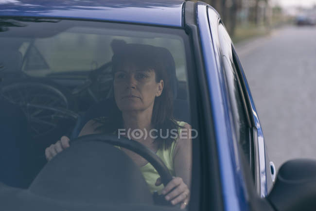 Portrait of serious Woman driving a car — Stock Photo