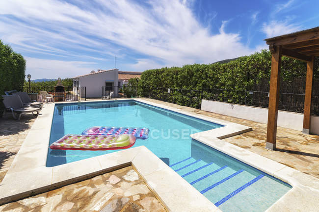 Spain, Andalucia, Finca and swimming pool with airbeds — Stock Photo