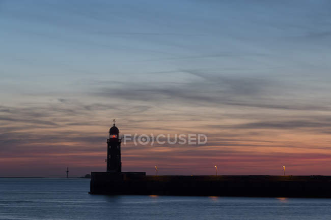 Weser view with lighthouse at sunset — Stock Photo